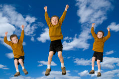 Young attractive boys jumping Royalty Free Stock Images