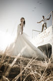 Young attractive bridal couple flirting outdoors Royalty Free Stock Photography