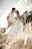 Young attractive bridal couple outdoors Royalty Free Stock Photography