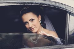 Young attractive bride gazing through the window Stock Photo