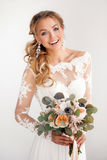 Young attractive bride with a wedding bouquet Stock Photo