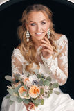 Young attractive bride with a wedding bouquet royalty free stock photo