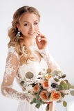 Young attractive bride with a wedding bouquet Stock Photos