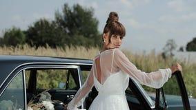 Young Beautiful Woman In Wedding Dress Posing Near Vintage Car.