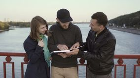 People have the conversation at the bridge stock video footage