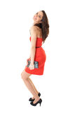 Young attractive brunette female in red dress Royalty Free Stock Images