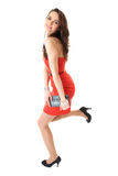 Young attractive brunette female in red dress Stock Photo