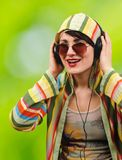 Young attractive brunette listens to music. Stock Photos