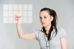 Portrait of brunette selecting from menu on virtual screen Royalty Free Stock Images