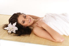 A young and attractive brunette on a spa procedure Royalty Free Stock Image