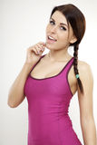 Sporty woman in violet dress standing and looking on camera Royalty Free Stock Photography