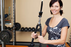 Young attractive brunette woman in the gym Stock Images