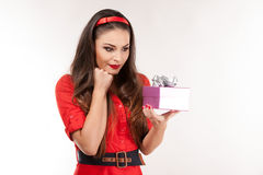 Young attractive brunette woman holding christmas gift. Stock Image