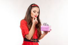 Young attractive brunette woman holding christmas gift. Stock Photo