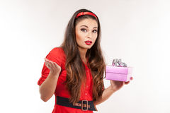Young attractive brunette woman holding christmas gift. Stock Photos