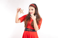 Young attractive brunette woman holding christmas star. Royalty Free Stock Photography
