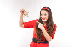 Young attractive brunette woman holding christmas star. Royalty Free Stock Photo