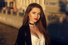 Attractive brunette woman posing against river on background Royalty Free Stock Photos