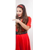 Young attractive brunette woman standing next to white board. Royalty Free Stock Photos
