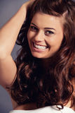 Young attractive bunette woman with glossy shiny hair Royalty Free Stock Images