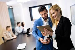 Attractive business couple using tablet in their company Stock Photo