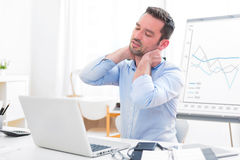Young attractive business feeling pain because of burn out Royalty Free Stock Photography