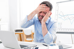 Young attractive business feeling pain because of burn out Royalty Free Stock Images