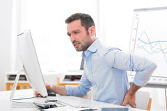 Young attractive business got backache because of burn out Royalty Free Stock Photo