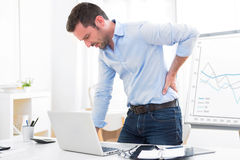 Young attractive business got backache because of burn out Royalty Free Stock Photography