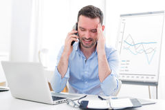 Young attractive business got headache because of mobile phone Stock Photo