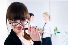Young attractive business lady. Pretty business women in office at collegues background Royalty Free Stock Image