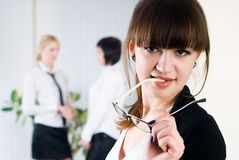 Young attractive business lady. Pretty business women in office at collegues background Stock Photos