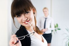 Young attractive business lady. Pretty business women in office at collegues background Royalty Free Stock Photography
