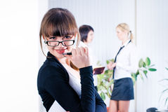 Young attractive business lady. Pretty business women in office at collegues background Stock Photo