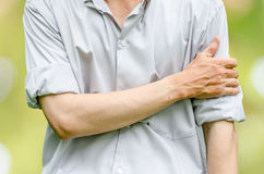 Young attractive business man having shoulder pain Stock Photo