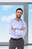 Young attractive business man standing in corporate portrait Royalty Free Stock Photo