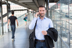 Young attractive business man using smartphone Stock Photo