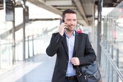 Young attractive business man using smartphone Royalty Free Stock Photo