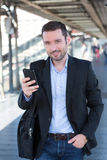 Young attractive business man using smartphone royalty free stock photos