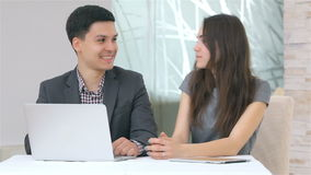 Young attractive business man and woman discussing stock video