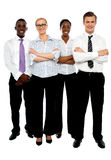 Young attractive business people. Arms folded Stock Image