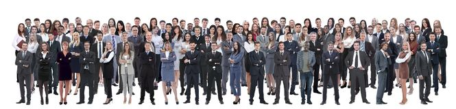 Business team formed of young businessmen and businesswomen standing over a white background stock images