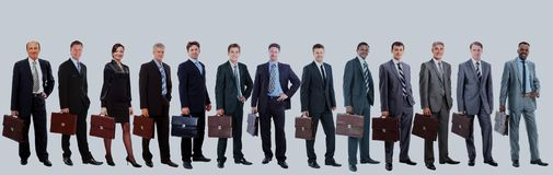 Young attractive business people - the elite business team. Royalty Free Stock Photography