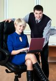 Young attractive business people work with laptop Stock Photo