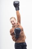 Young attractive business woman with boxing gloves Royalty Free Stock Photo