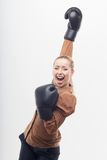 Young attractive business woman with boxing gloves Royalty Free Stock Image