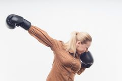 Young attractive business woman with boxing gloves Royalty Free Stock Photos