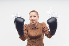 Young attractive business woman with boxing gloves Royalty Free Stock Photography
