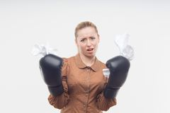 Young attractive business woman with boxing gloves Royalty Free Stock Images