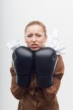 Young attractive business woman with boxing gloves Stock Photo